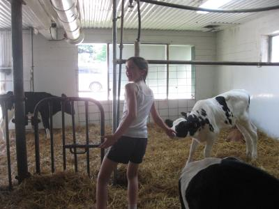Girl Scout with baby calf
